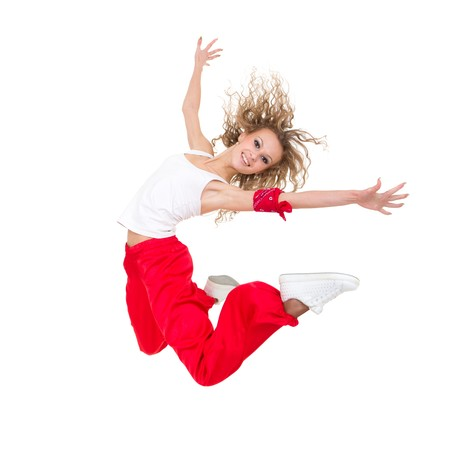 Happy young dancer jumping against isolated white background