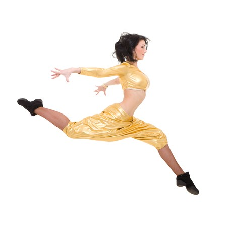 Attractive young dancer jumping against isolated white background photo