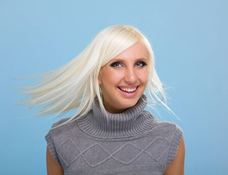 Portrait of pretty woman with flying blond hair Stock Photo - 8332004