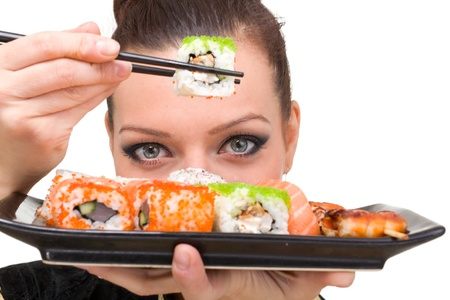 model fish: Close up portrait of young woman with sushi Stock Photo