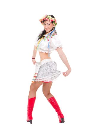 Attractive woman wearing a folk ukrainian dress posing against isolated white background photo