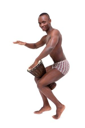 Happy man drumming on  tomtom on a white background photo