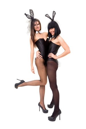 playgirls wearing a bunny costumes posing against isolated white background Stock Photo - 8430131