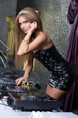 Beautiful and sexy DJ woman on decks on the party Stock Photo