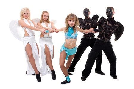 Dance team dressed as angels and demons posing against isolated white background photo