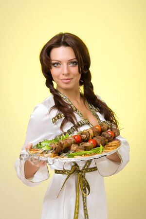 sexy young woman posing with a barbecue photo