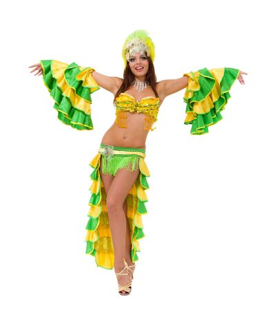 Beautiful carnival dancer dancing against isolated white background photo