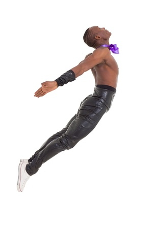 Jump. Young man dancing over a white background photo