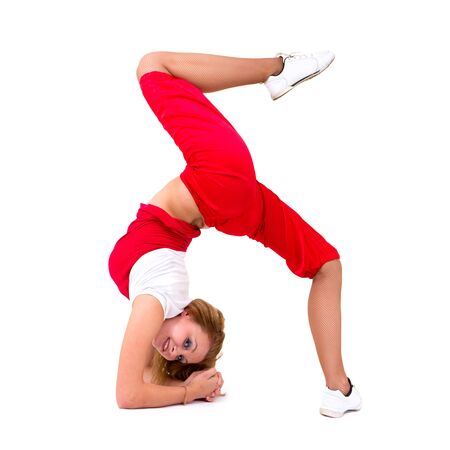 Young hip-hop dancer posing on a white background Stock Photo