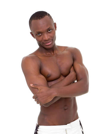 Young man with muscular body isolated on a white background photo