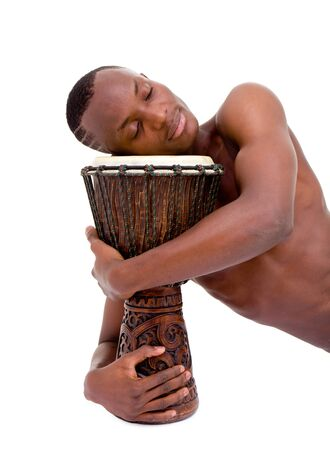 sleeping man with the african drum lies on a isolated white background photo
