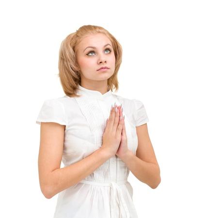 mano de dios: mujer joven modesto rezando, aislado en fondo blanco Foto de archivo