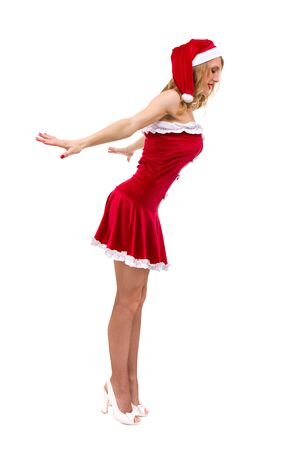 Young woman wearing santa claus clothes posing against isolated white background photo
