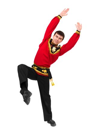 russian tradition: young man wearing a folk russian costume dancing against isolated white background