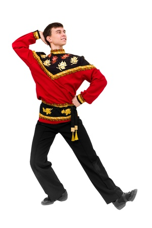 young dancer wearing a folk russian costume dancing against isolated white background photo