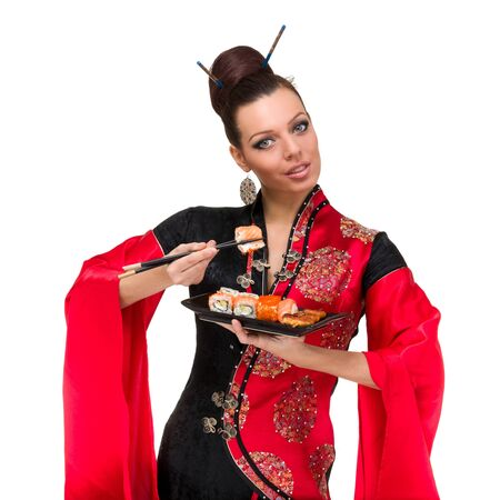 Woman in traditional dress with sushi, isolated on white background  Stock Photo - 15531569