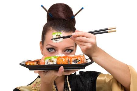 Close up portrait of young woman with sushi Foto de archivo