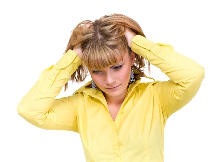 Depressed young woman wearing a yellow shirt against isolated white background Stock Photo - 15548143