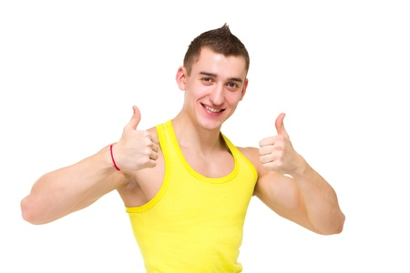 Happy young man with thumbs up gesture, isolated on white background  photo