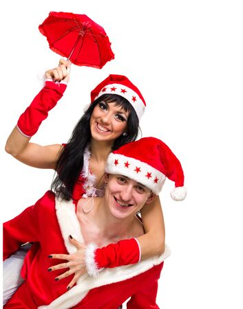 Happy couple wearing santa claus clothes posing against isolated white background photo