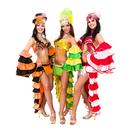 Three carnival dancers posing against isolated white background
