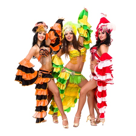 Three young sexy carnival dancers posing against isolated white background photo