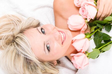 lovely happy woman with a bouquet of roses photo