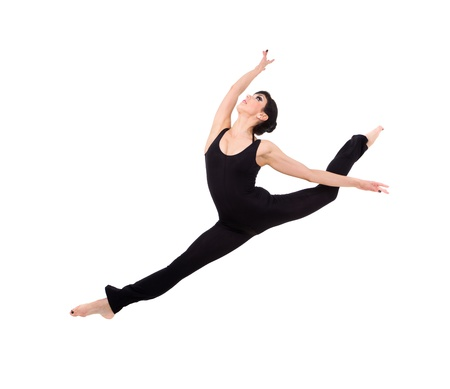 acrobat woman makes splits, jumping against isolated white background photo