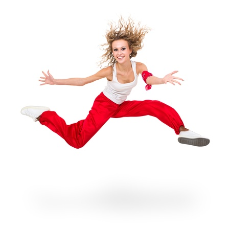 Modern teenage girl dancer jumping against isolated on a white background photo