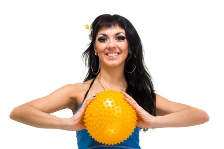 Young smiling woman with fitness ball over white background Stock Photo - 16193187