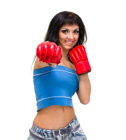 Smiling woman boxing, isolated over a white background photo