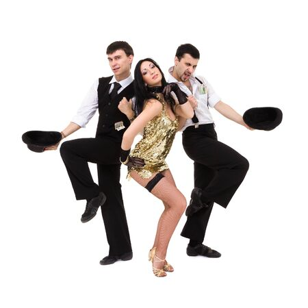 three  young old-fashioned dancers dancing, isolated over white background  photo