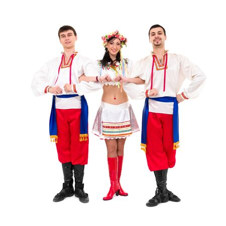 three dancers wearing a folk ukrainian costumes posing against isolated white background photo