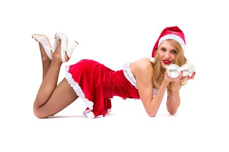 sexy girl wearing santa claus clothes posing against isolated white background photo