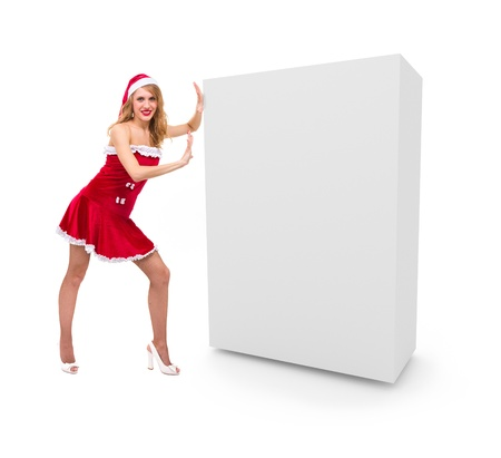 Christmas girl pushes a blank box  Ready to use in your designs  photo