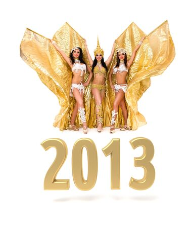 Three belly dancers with 2013 New Year gold sign isolated on white photo
