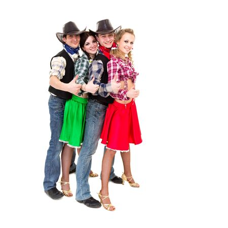 Smiling cowboys and cowgirls with thumbs up gesture, isolated on white background  photo
