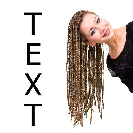 Beautiful young woman with dreadlocks against isolated white background, with copy space photo