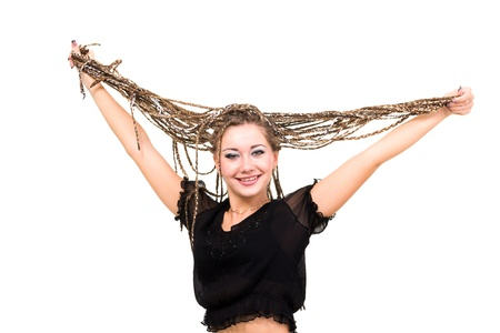 friendly smiling young woman with dreadlocks against isolated white background photo