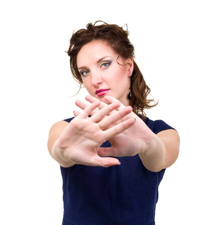 Portrait of young attractive brunette woman with hands as sign to stop against isolated white background Stock Photo - 16588126