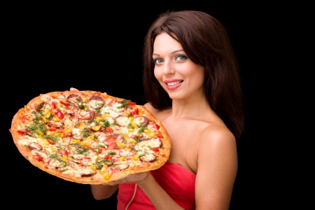 young woman with pizza against a black background photo