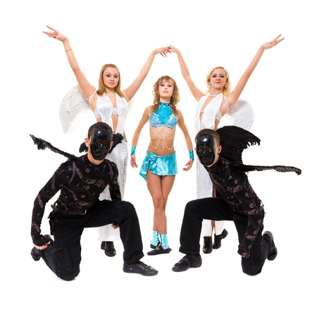 Actors dressed as angels and demons posing on an isolated white background photo