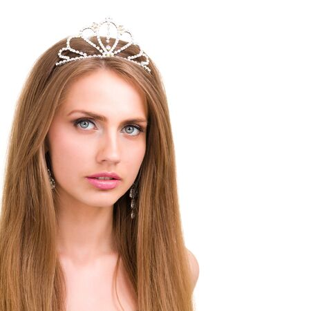 Close up portrait of beautiful girl with diadem, isolated on white background photo