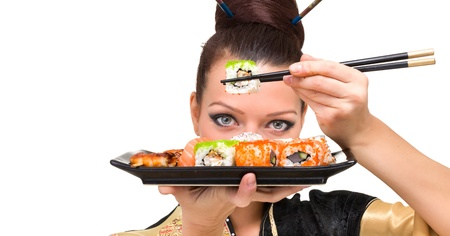 Close up portrait of young woman with sushi, isolated on white background with copyspace photo