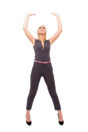 woman wearing a fashionable jumpsuit with holding gesture on an isolated white background photo
