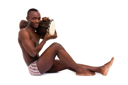 Sexy man with tomtom posing on a white background photo