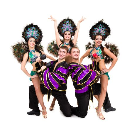 Dancers in carnival costumes posing on a white background photo