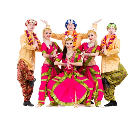 bollywood woman: dance team dressed in Indian costumes posing   Isolated on white background in full length  Stock Photo