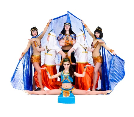 dance team dressed in Egyptian costumes posing   Isolated on white background in full length  photo