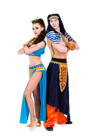 dance couple dressed in Egyptian costumes posing   Isolated on white background in full length  photo